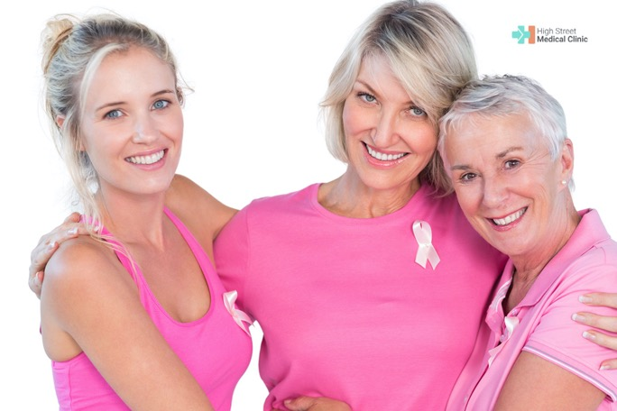 A women wearing the pink ribbon smiling for the breast cancer awareness month 2021